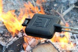 cast iron pie iron over a campfire